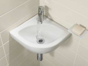 Угловая раковина в ванную: выбор и установка